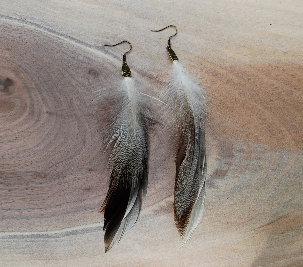 finished pair of cheap and easy handmade feather earrings