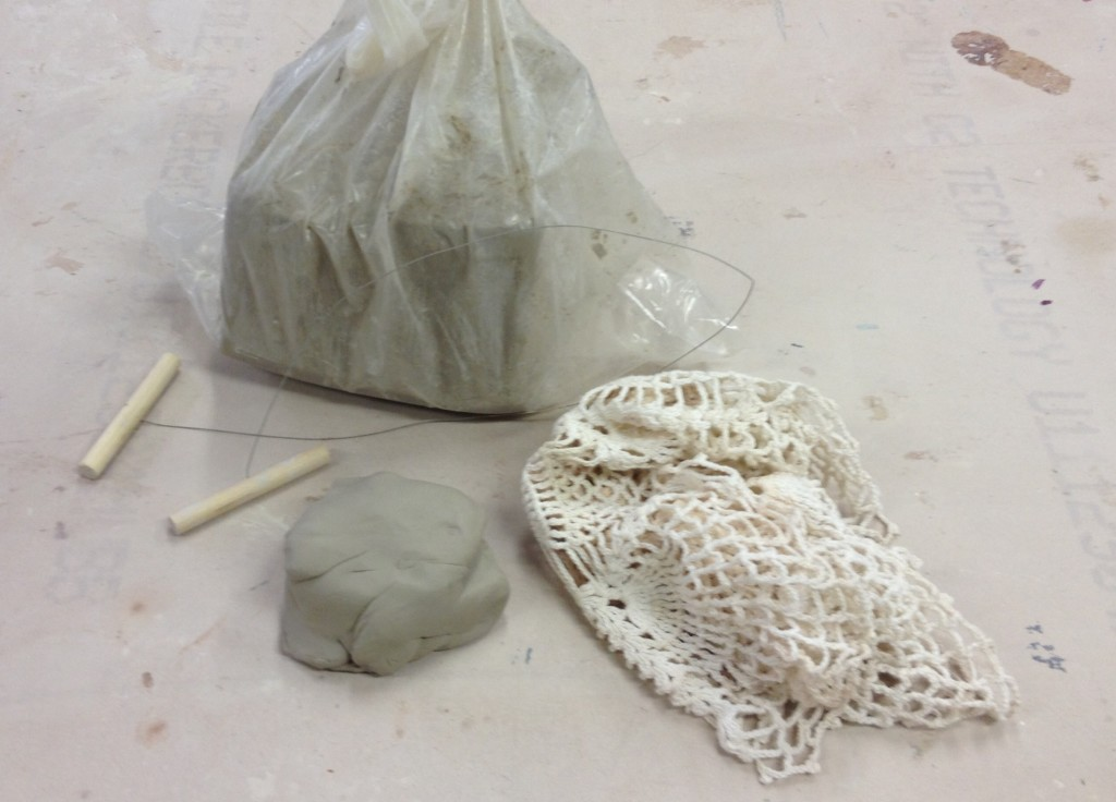 Wet clay and tools